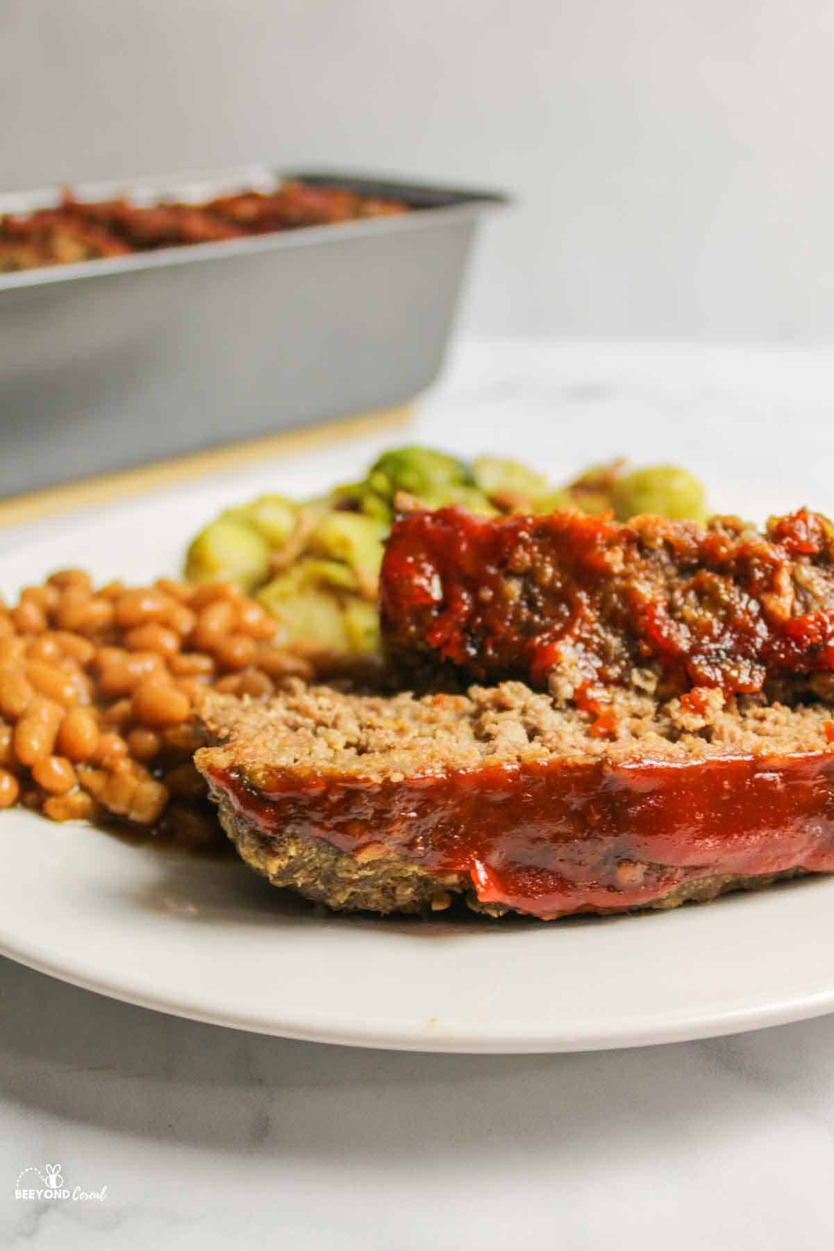 two close up slices of oat meatloaf on a plate
