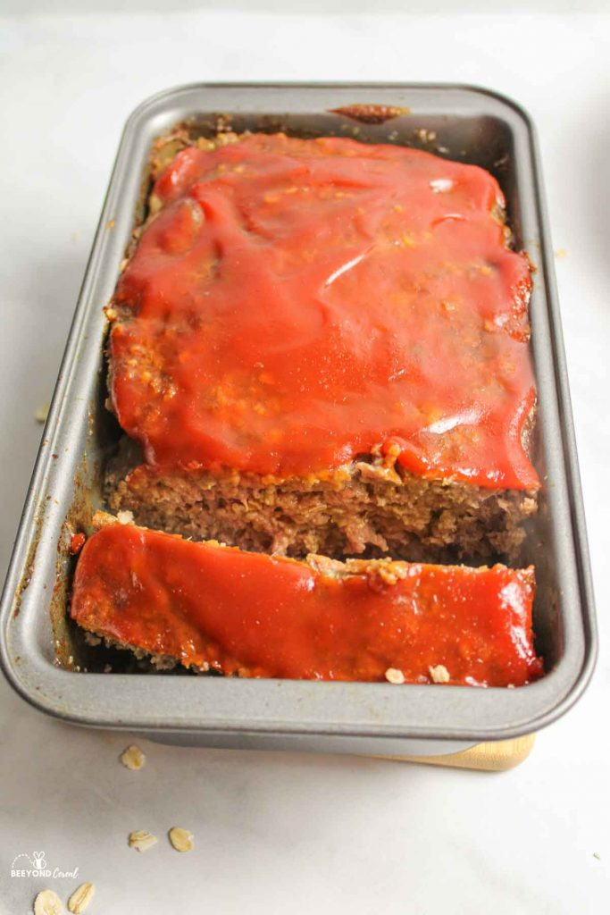 a slice of meatloaf in a bread pan