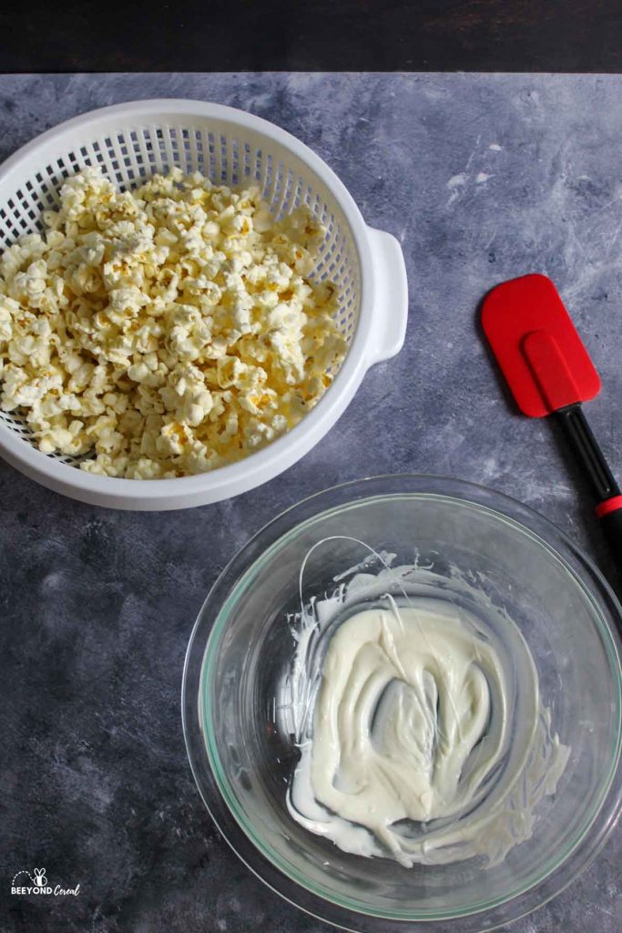 aerial view of popcorn and melted chocoalte with red spatula to the side