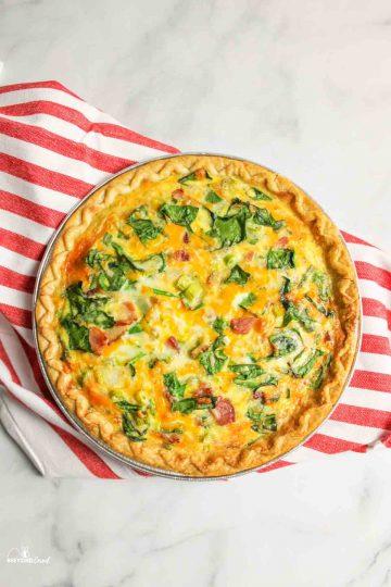 aerial view of baked spinach bacon quiche