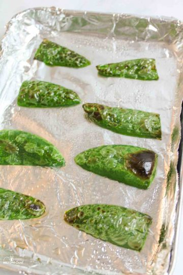 oven roasted jalapeno on a foil lined baking sheet