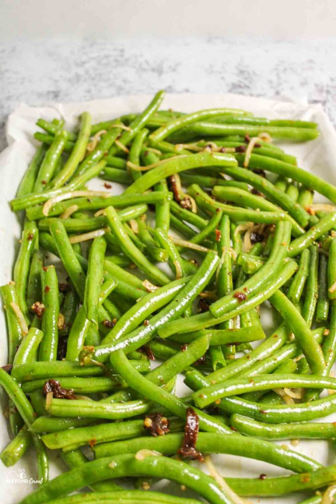 italian green beans unbaked on a parchment lined baking sheet