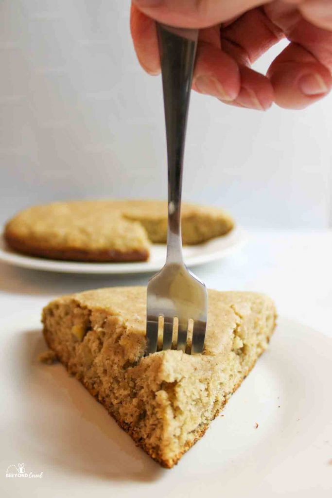 a fork digging into a slice of stovetop banana bread