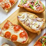 baked french bread pizzas of different varieties