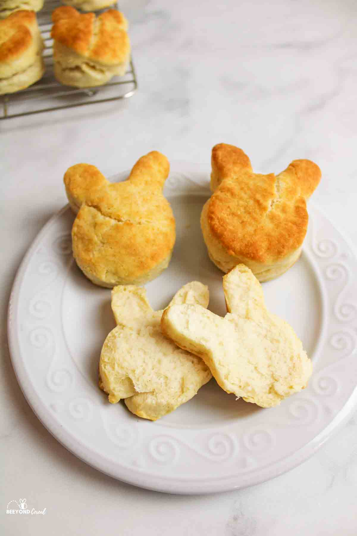 bunny biscuits on a white plate one split open to reveal soft inside