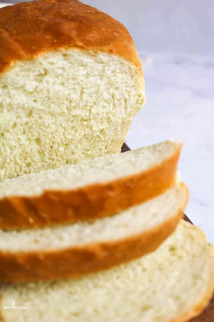 an upclose view of sliced homemade white bread