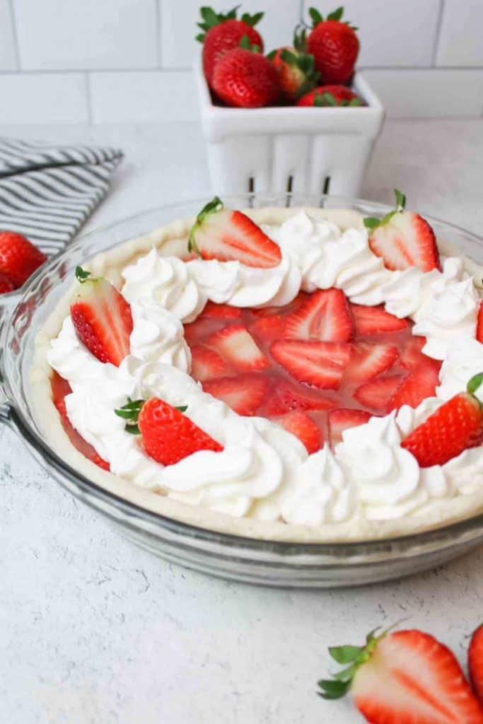 half of a strawberry pie in a crust