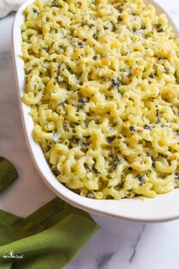 a baking dish filled with spinach macaroni