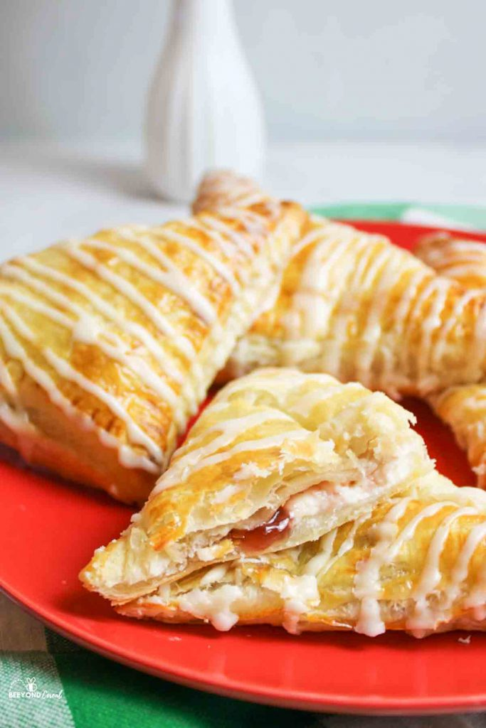 strawberry cream cheese turnovers on a red plate