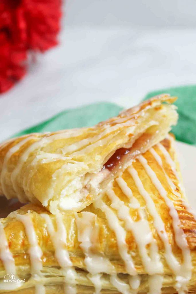 upclose view of filling inside a sliced strawberry cream cheese turnover