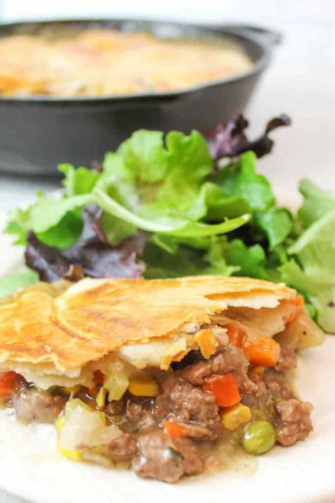 an upclose view of the gravy filled pot pie with ground beef and veggies