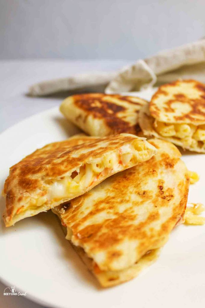 sliced mac and cheese quesadillas stacked on a plate