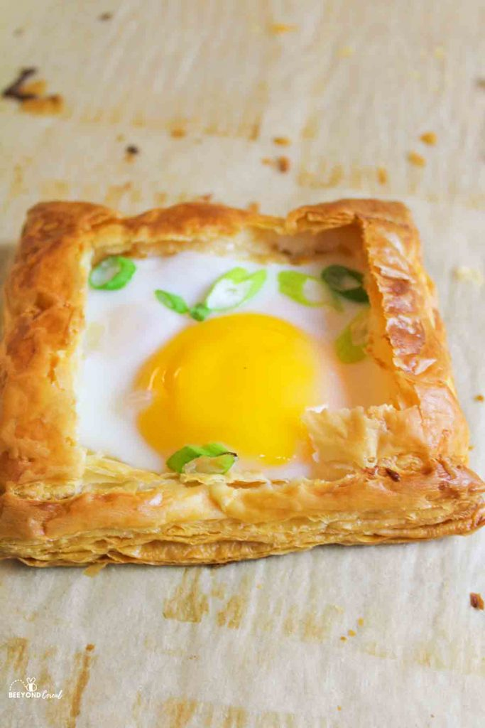 a puff pastry egg tart on parchment paper