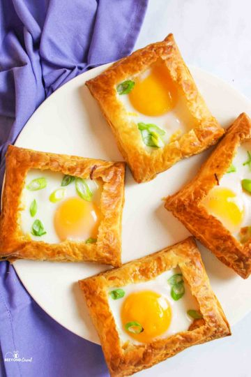 aerial view of egg tarts on a plate