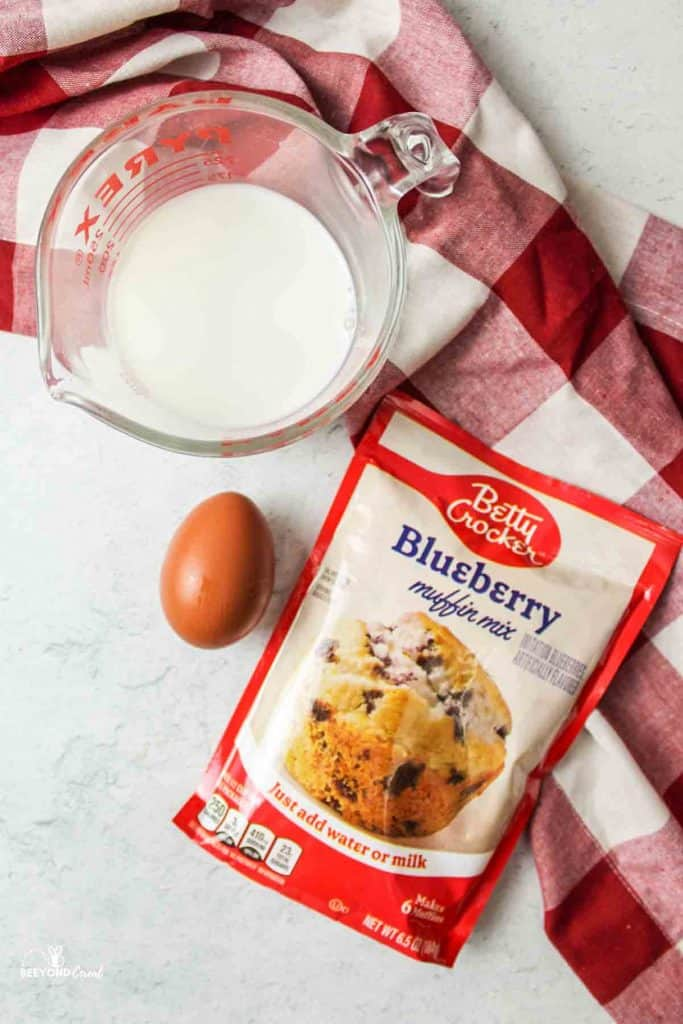 a package of blueberry muffin mix in a skillet with a towel wrapped around the handle