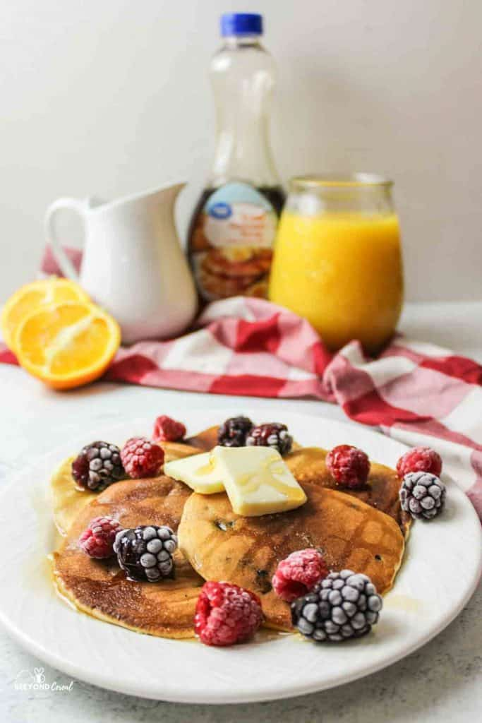 whole wheat blueberry muffin mix pancakes stacked on a plate
