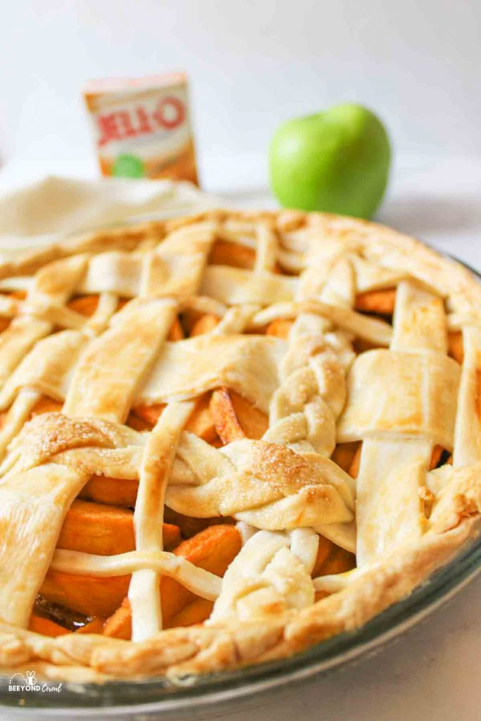an upclose view of butterscotch apple pie baked and given a braided lattice top