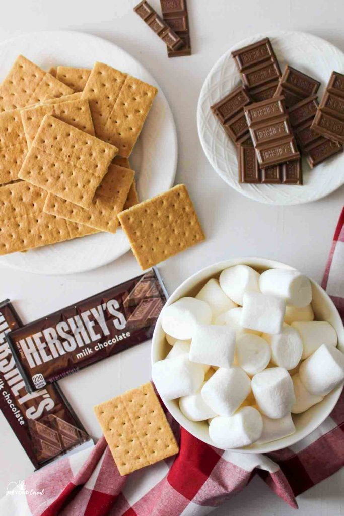 ingredients needed to make smores graham crackers, chocolate, and marshmallows