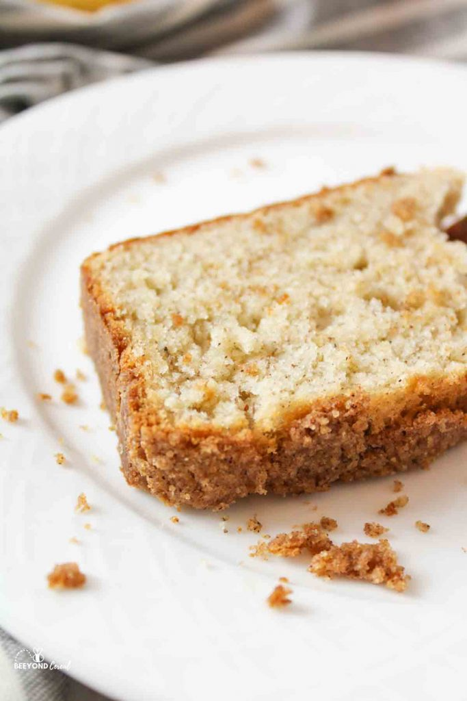 a slice of cinnamon crumble banana bread on a whtie plate