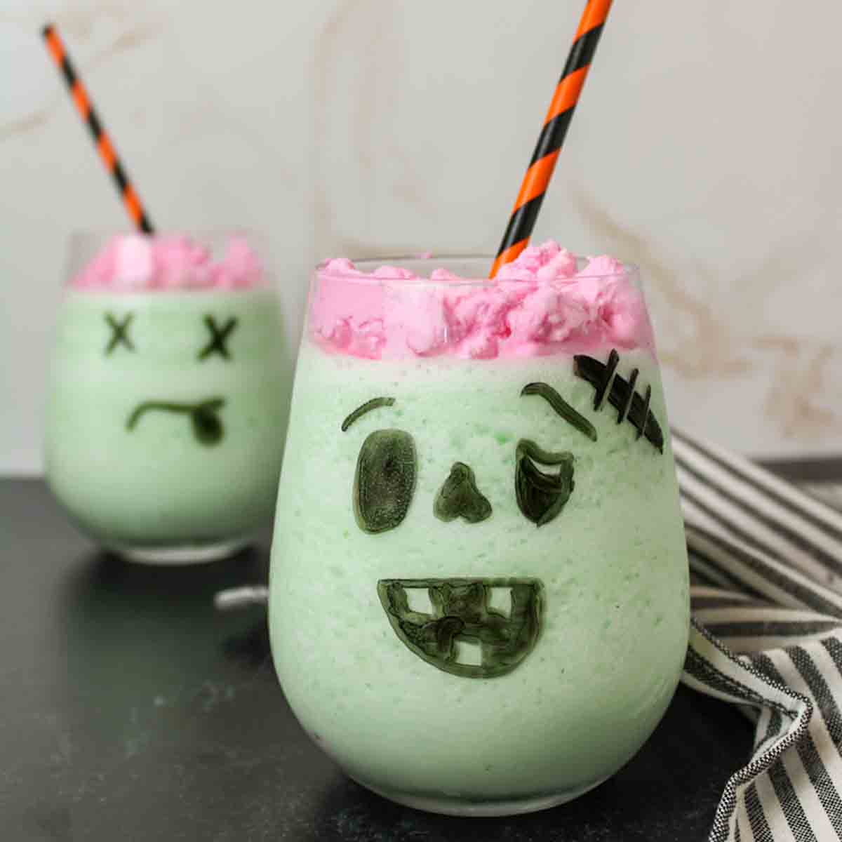 an upclose view of a glass full of frozen whipped zombie brain drink
