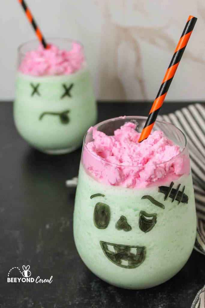 two glasses of frozen whipped zombie brains with straws