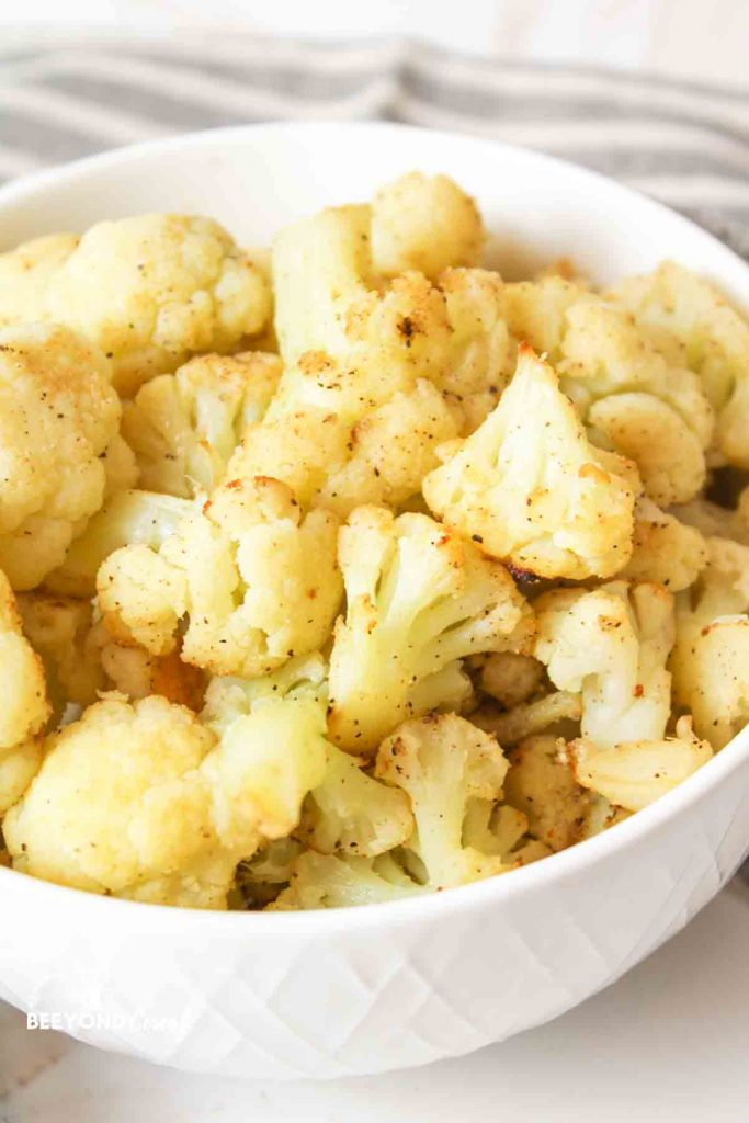 a bowl filled with roasted frozen cauliflower