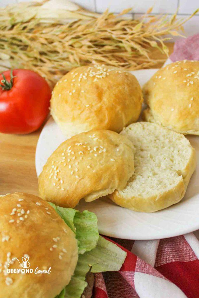 vegan sesame seed burger buns split open to reveal tight sot crumb inside