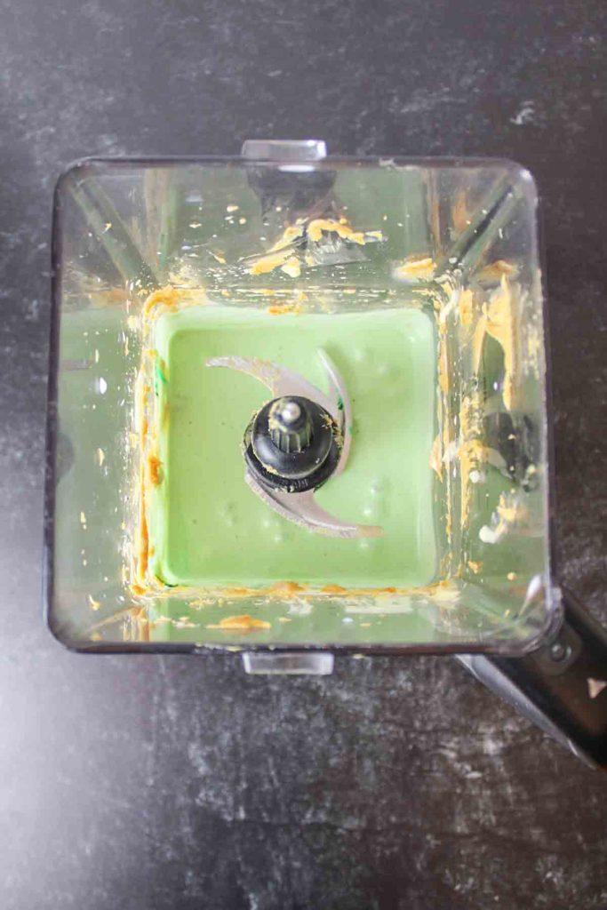 aerial view of green zombie milkshake in blender