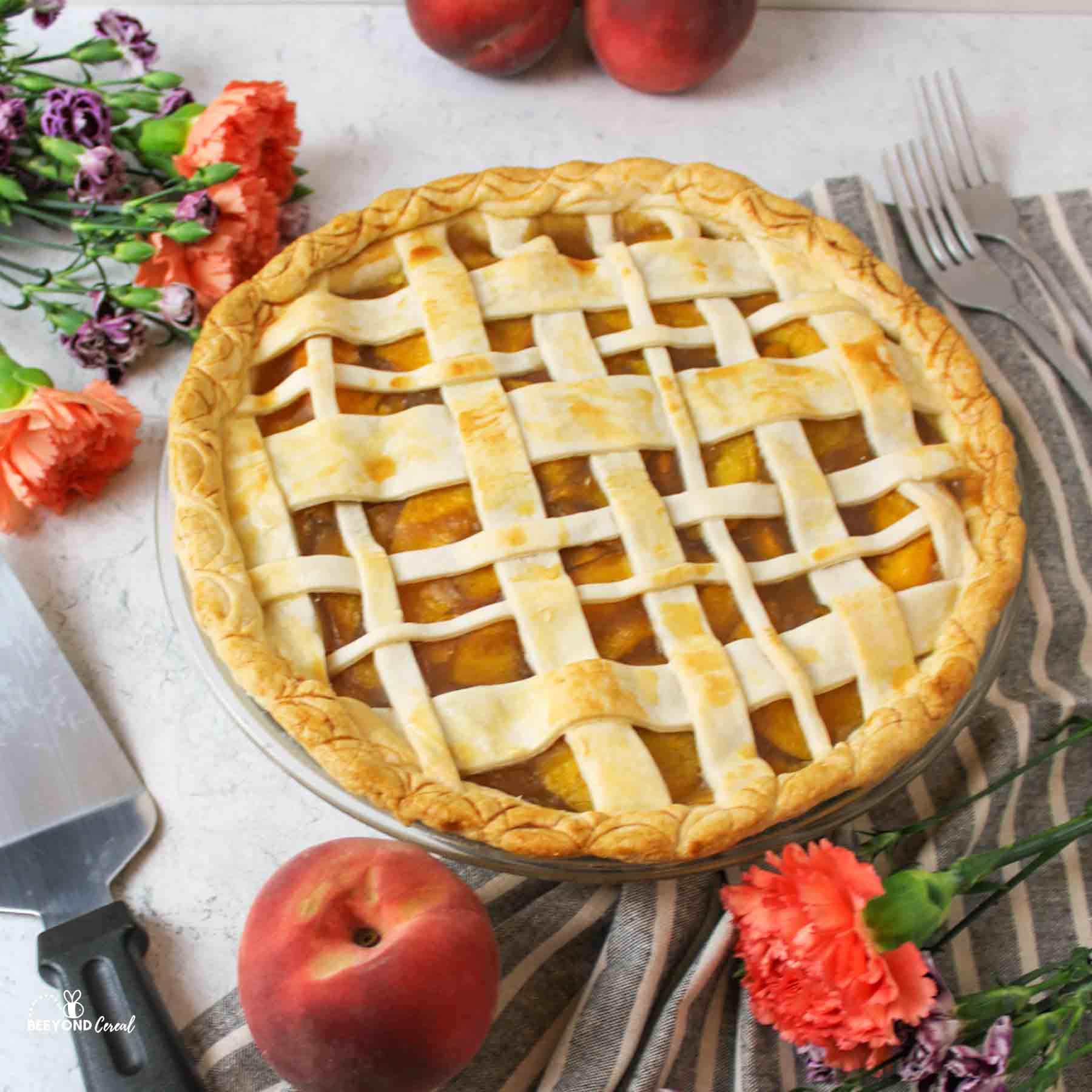 a close up of a fresh baked peach pie