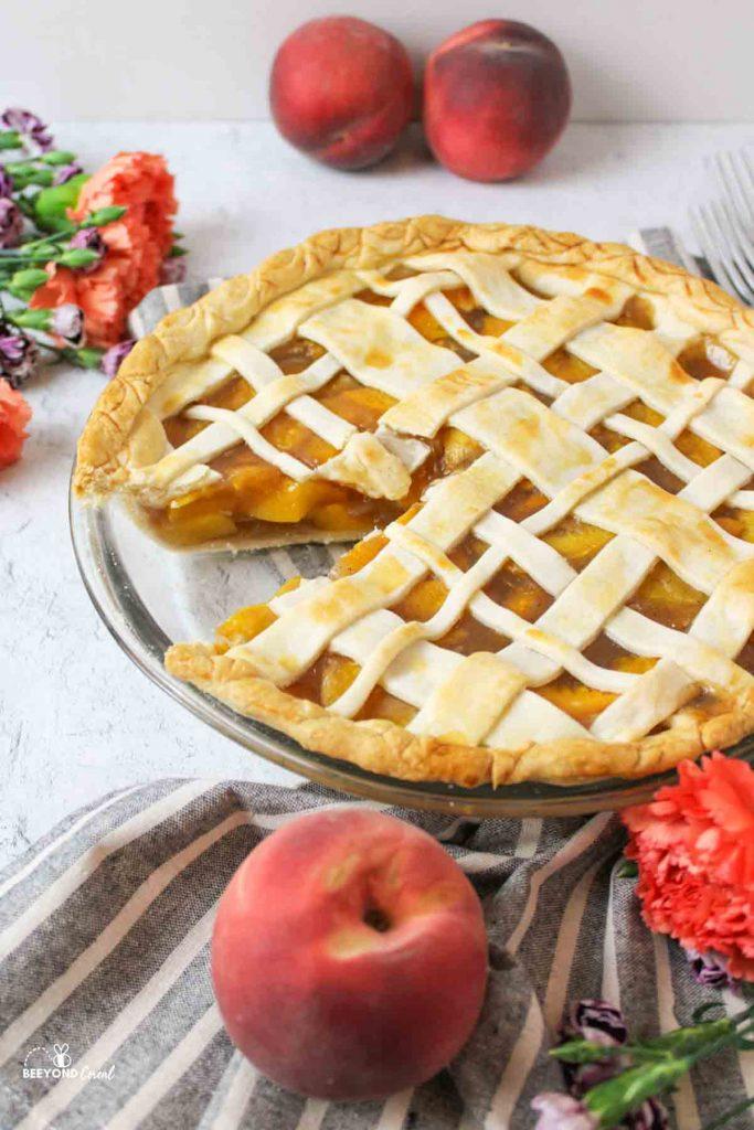 a peach pie missing a slice