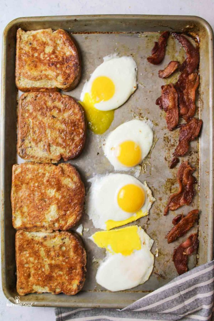 aerial view of a sheet pan french toast breakfast with eggs and bacon