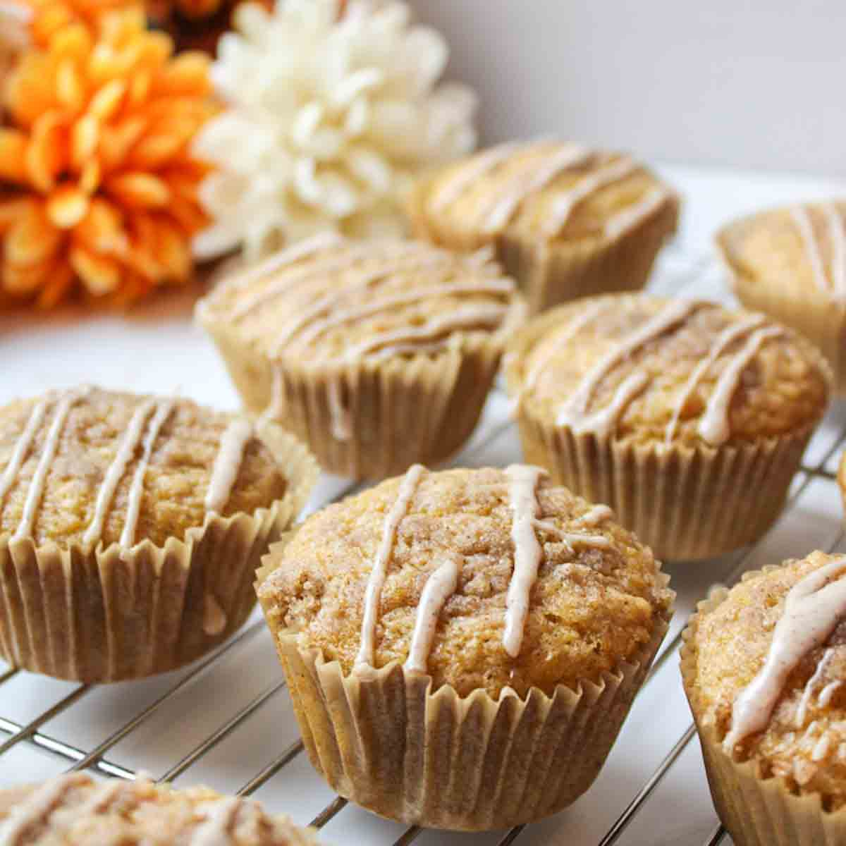 an upclose view of sweet potato muffins on a wire rack