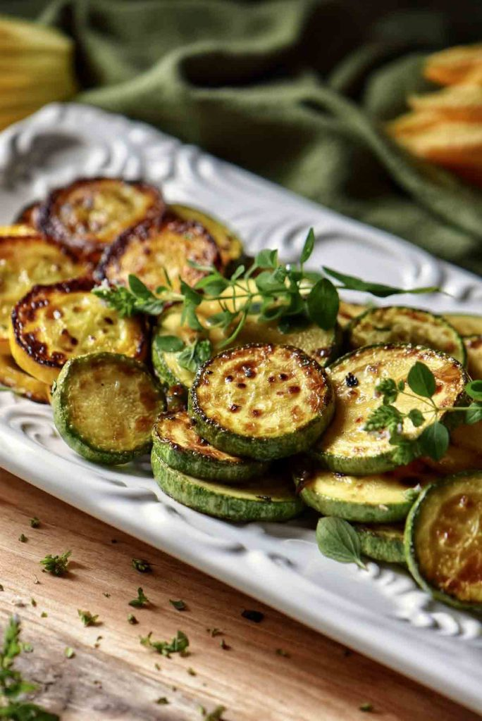 a rectangular plate filled with sauteed zucchini